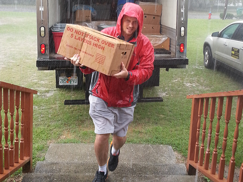 DH's Executive Director delivering case of food to church in Crestview