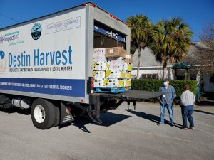 Destin Harvest making delivery to local church